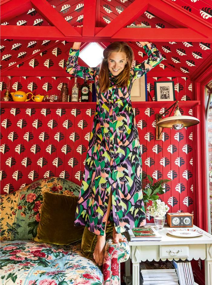 Beata Heuman in her garden studio, with paintwork by TheFinished Effect, Beata Heuman loveseat covered in Pierre Frey fabric, Julian Chichester light and vintageside table
