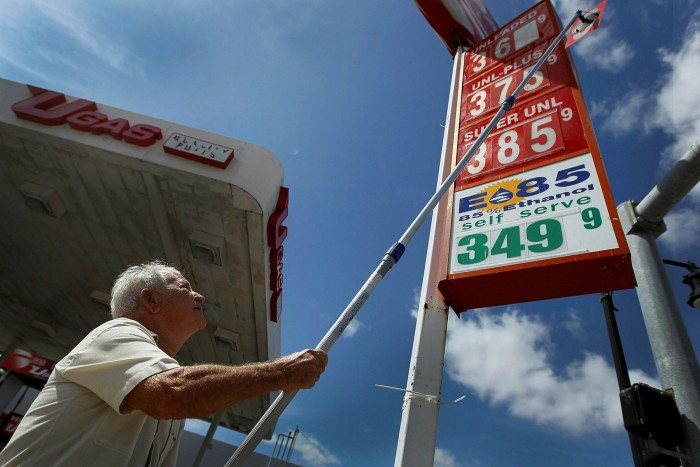 A man changes the fuel prices at a service station in Florida. The president has felt the need to vow vigilance on inflation and acknowledge the struggles of Americans facing higher prices for food, petrol, housing and other key expenses