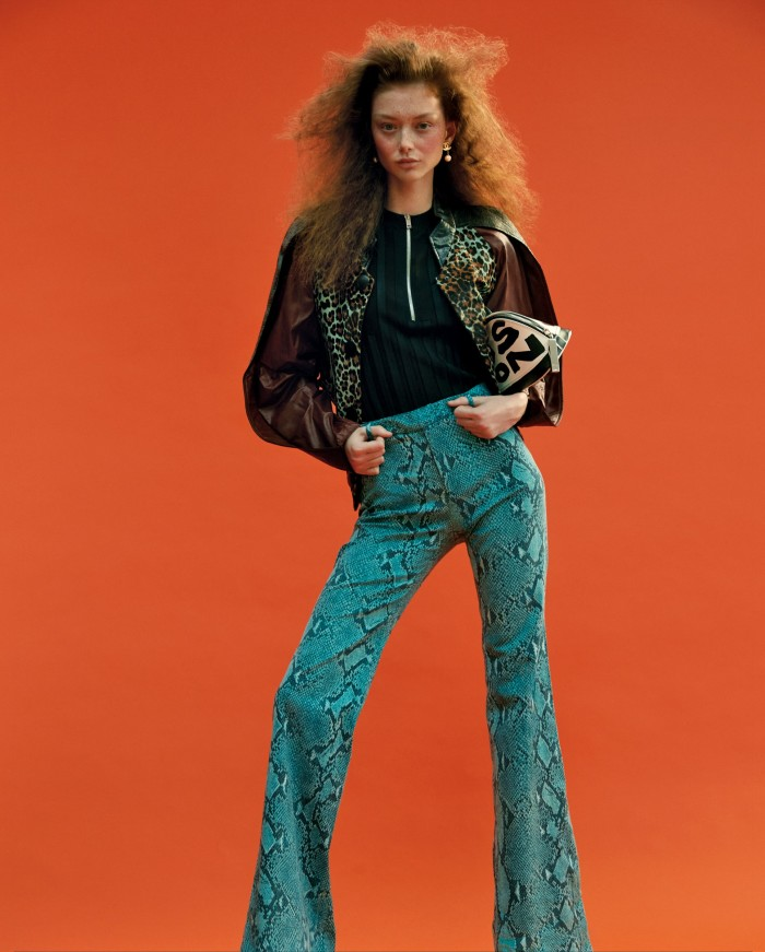 Jacket: Balenciaga by Nicolas Ghesquière pre-fall 2012, POA, from Alexander Fury Archive. Top: Céline by Phoebe Philo s/s2017, £200, from Hewi. Python-print jeans: Gucci by Tom Ford s/s 2000, stylist's own. Earrings: Chanel 1980s, £235,from Hewi. Bag: Louis Vuitton by Stephen Sprouse 2001 Alma, POA, from Alexander Fury Archive