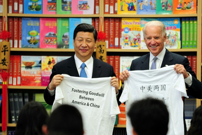 Joe Biden and Xi Jinping display shirts given to them by students at the International Studies Learning Center in Southgate, outside LA, in February 2012
