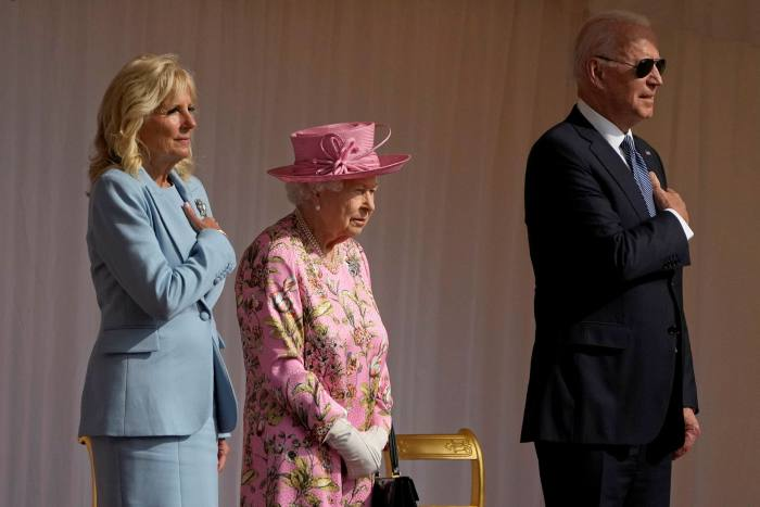 Joe Biden and First Lady Jill Biden with Queen Elizabeth II listening to the national anthems at Windsor Castle