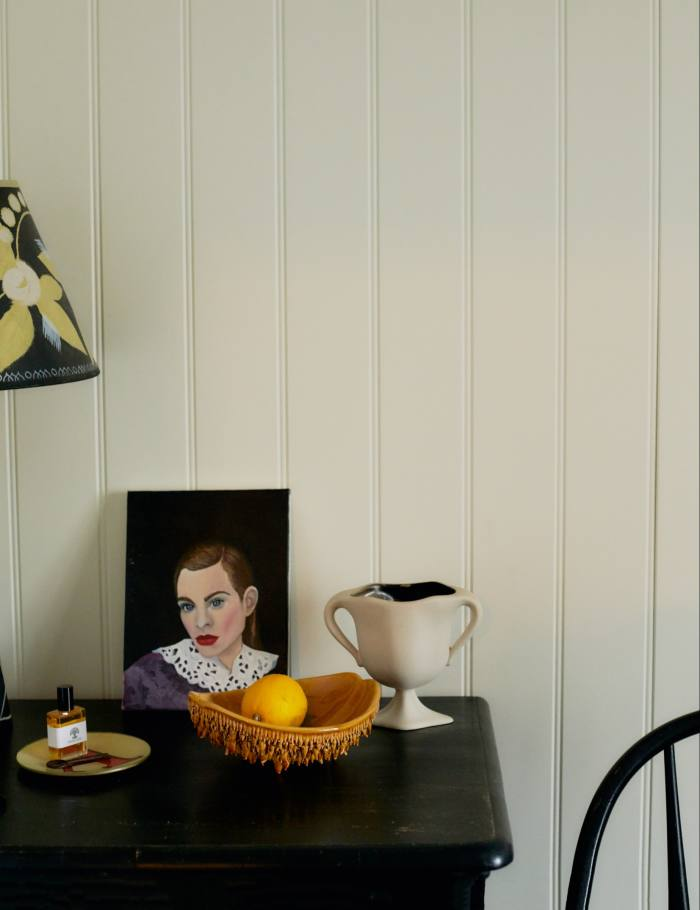 A painting of Chung by C Kelly, a John Derian dish and Moro Dabron candleholder