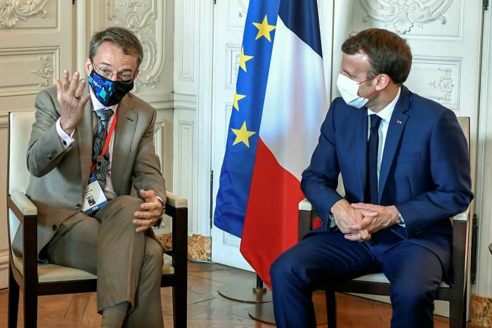 French President Emmanuel Macron (R) with Intel chief Patrick Gelsinger during an international business leaders' meeting in Versaille last month