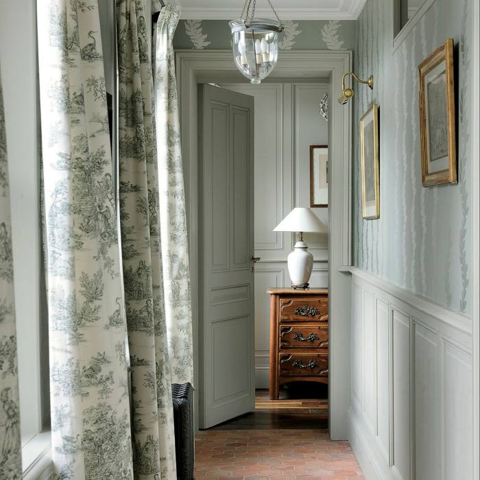 The hotel is decorated with antiques and toile de Jouy details
