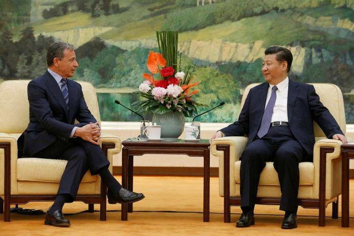 China's president Xi Jinping, right, meets Bob Iger, then Disney chief executive, in 2016