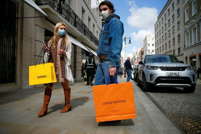 A shopper carries a Louis Vuitton bag in central London