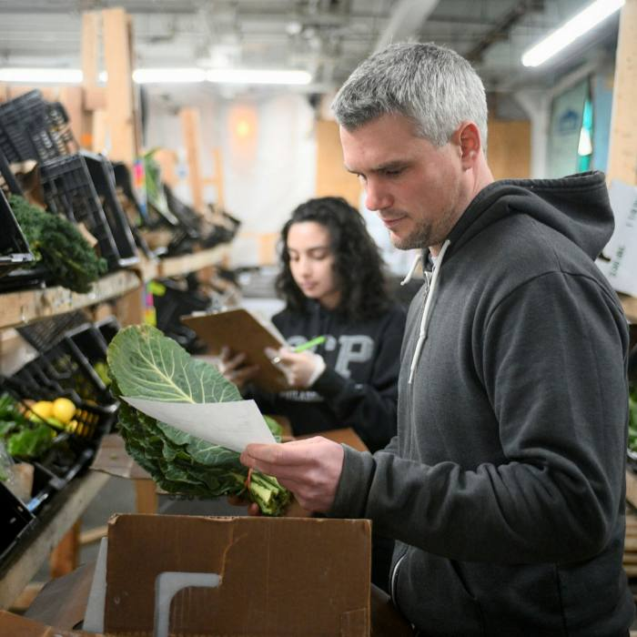 Dylan Baird, Co-Founder of Philly Foodworks, Helps Crew Members Choose Items For Online Order In January