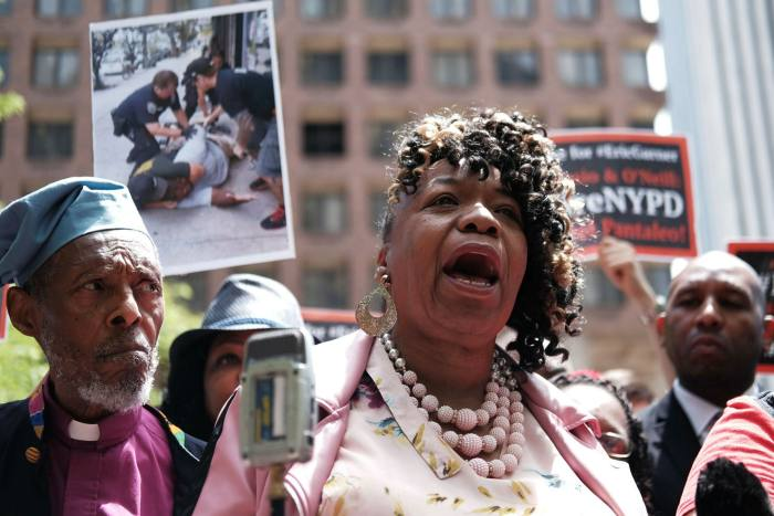 Gwen Carr, the mother of Eric Garner, joins protesters outside the Manhattan police headquarters