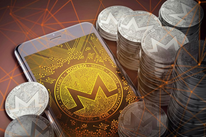 Monero on-screen among piles of Monero coins