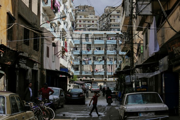A boy crosses a street in a slum in Tripoli, northern Lebanon. Ashmore has built up a huge stake in Beirut's debt that in practice gives it a veto over how the country will restructure some of its bonds