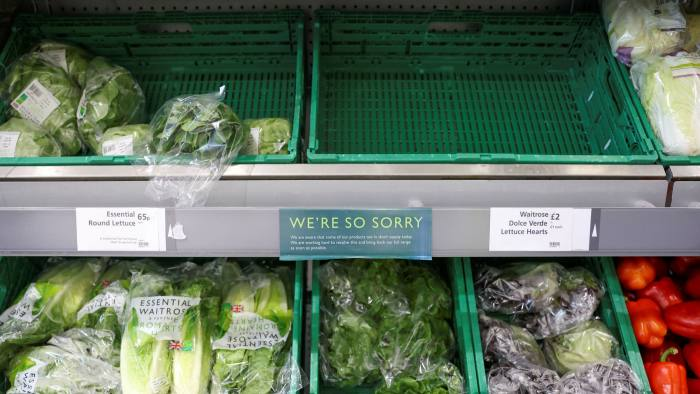 An empty vegetable crate in a Waitrose shop in London