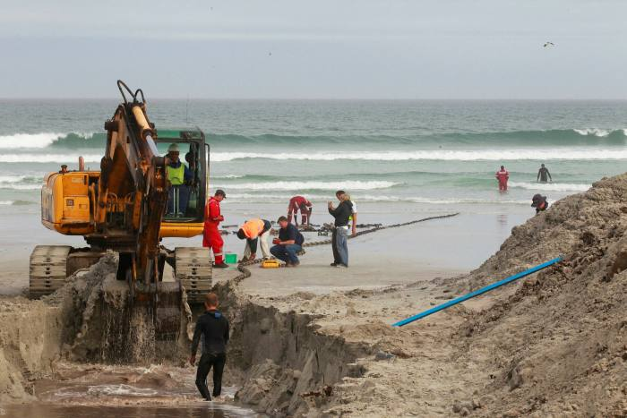 Workers dig a trench in Western Cape to lay an ultra-high capacity cable linking southern Africa and Europe. Facebook is among backers of the 37,000km 2Africa cable intended to circumnavigate Africa by 2023 or 2024