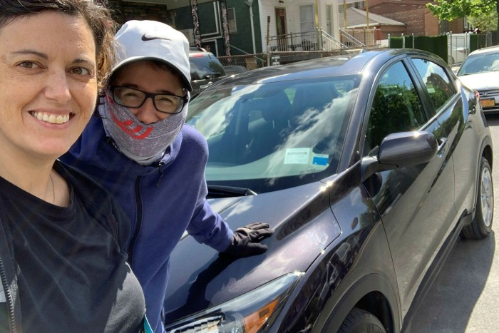 Rebecca Coleman, right, and her wife Nicole in New York with their new car, which they bought online without visiting a forecourt, or taking a test drive