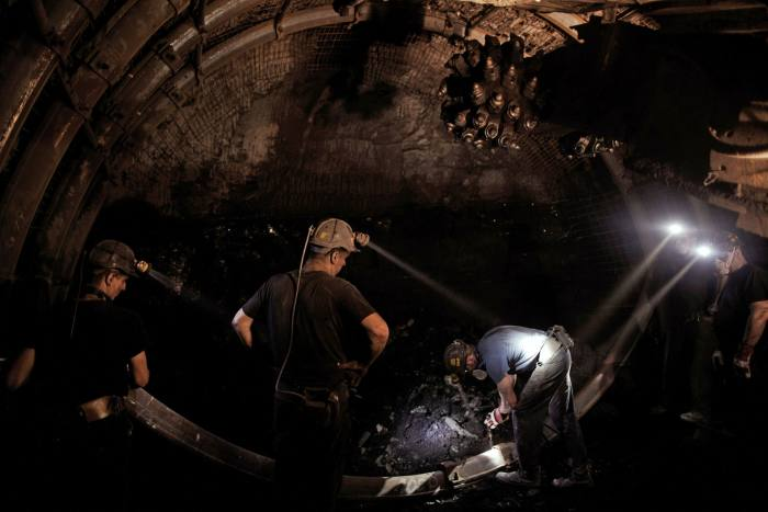 Coal miners work underground in the Piniowek coal mine. Until the 1980s, Poland was one of the world's top five producers