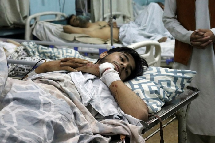 Afghans injured in the suicide bomb attack at Kabul airport lie in hospital beds in the Afghan capital. The blast, claimed by an Isis affiliate group, killed at least 60 Afghans and 13 US troops