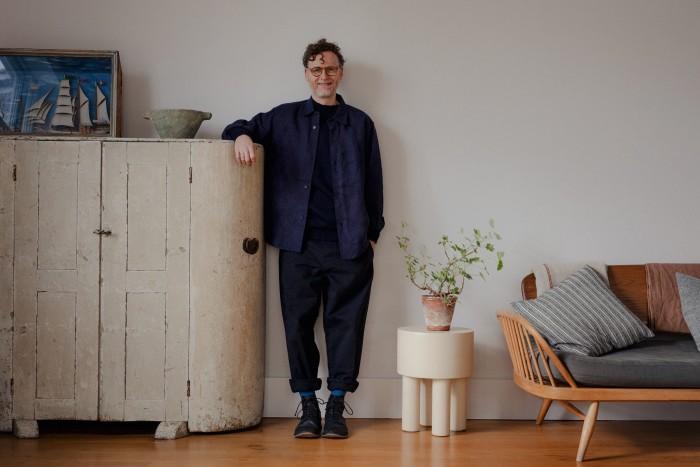 Matt Gibberd wears Margaret Howell denim canvas shirt, £375, MHL. by Margaret Howell merino crew neck jumper, £125, cotton drill trouser, £335. Glasses, shoes, socks and ring, his own