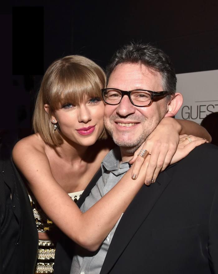 Music artist Taylor Swift hugging music executive Lucian Grainge
