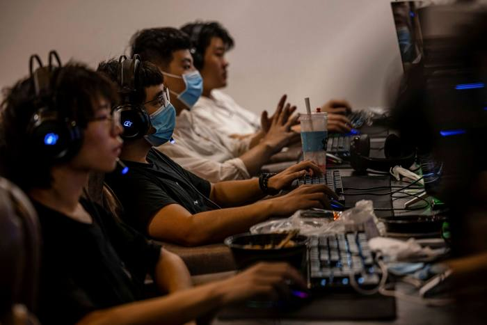 People play games in the video gaming centre in Shanghai