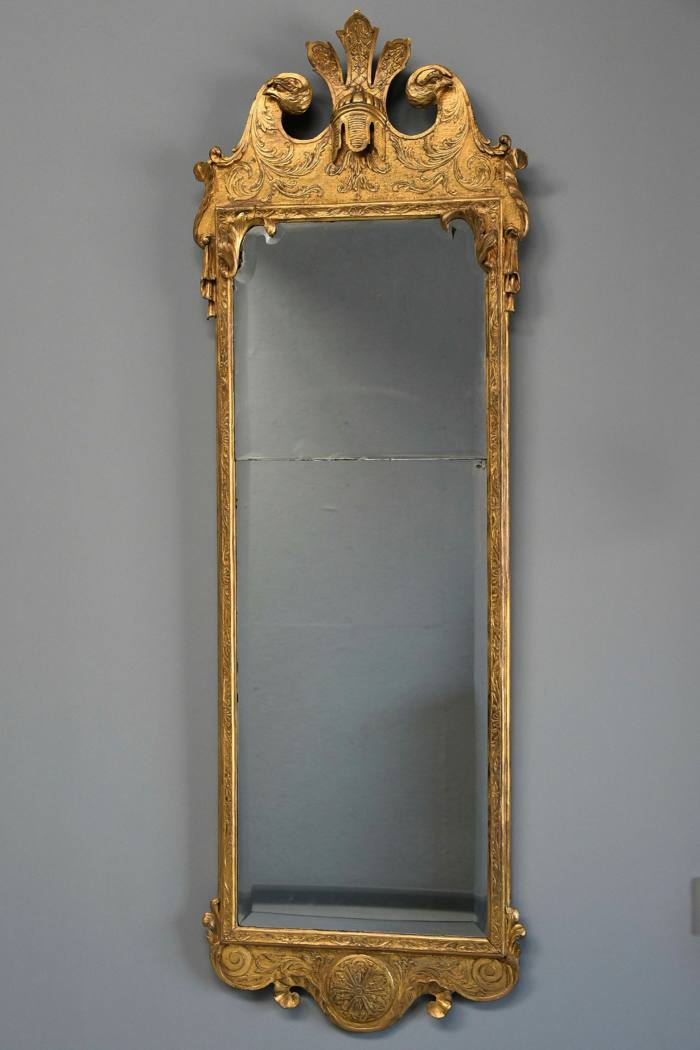 The rare George I gilt wood and gesso mirror that features a broken scroll arched pediment at LVS Antiques