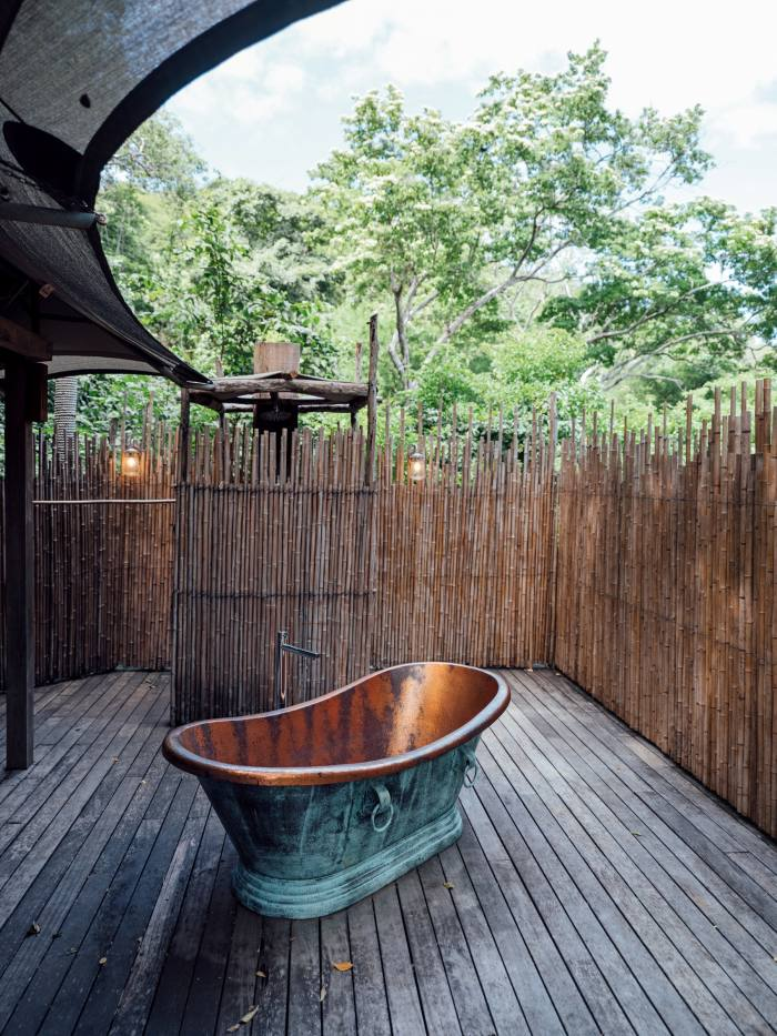 The rooms have open-air showers and copper tubs