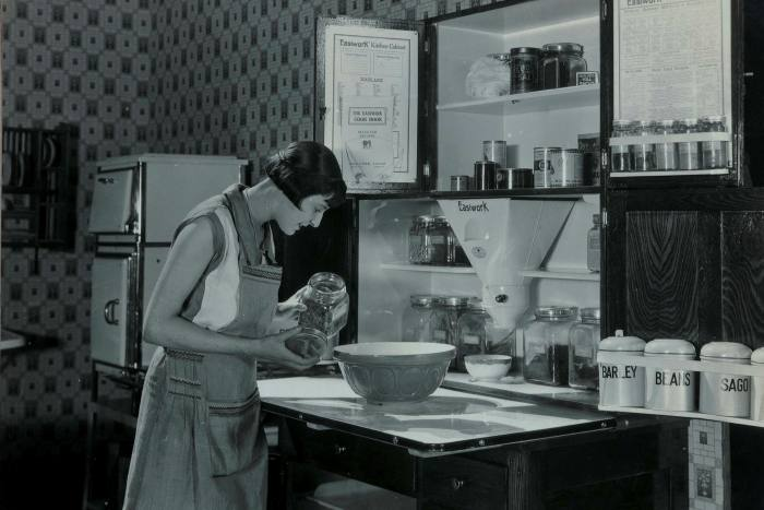 A woman demonstrating Easiwork cabinet