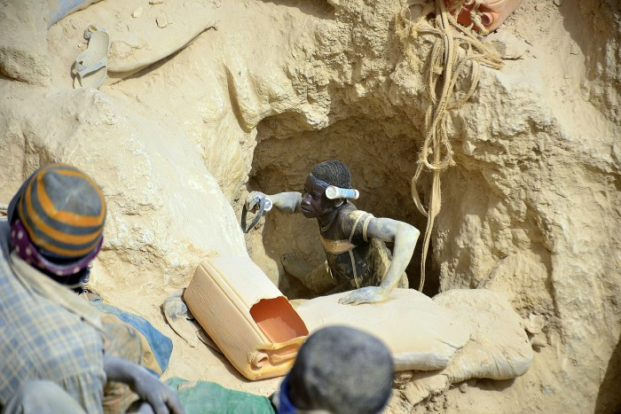 A young miner exits the well of a clandestine gold mine in the village of Nobsin, 10km from the city of Mogtedo in the Ganzourgou region