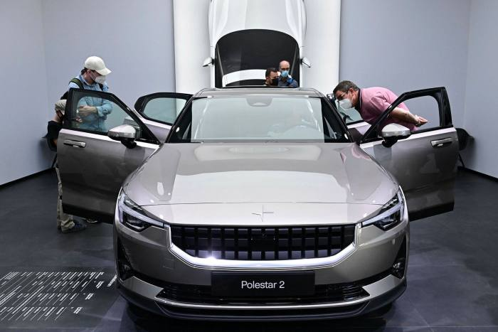 Visitors check out a Polestar 2 car at the International Motor Show in Munich, southern Germany, this month