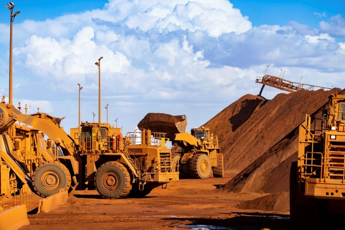 Excavators at an iron ore mine in Australia. The cost of commodities critical to the global economy, including copper and iron ore, have soared