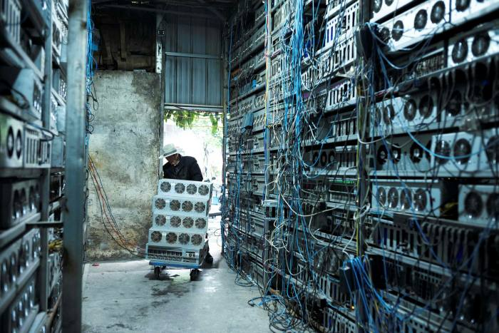 Workers at a cryptocurrency farm in Dujiangyan, in China. Despite government crackdowns, the country remains an important global crypto market