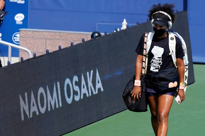 Naomi Osaka arrives for a match at the Western & Southern Open tennis tournament in New York in August  wearing a Black Lives Matter shirt