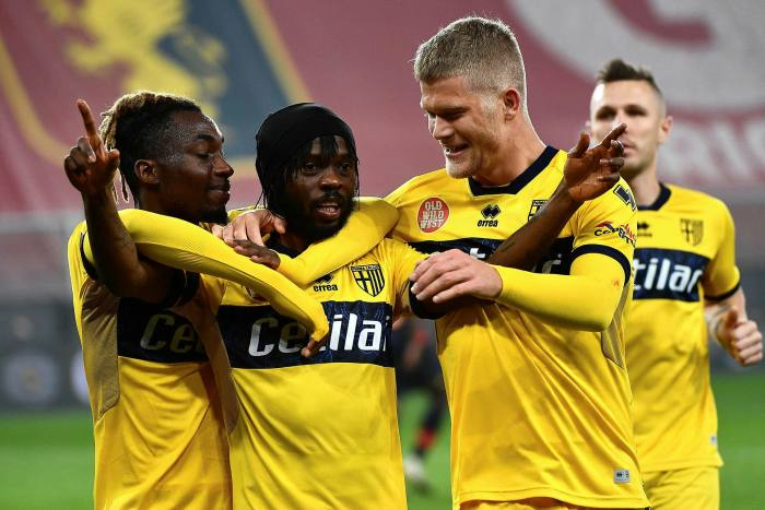 Parma's Gervinho, centre, celebrates with teammates after scoring against Genoa on Monday