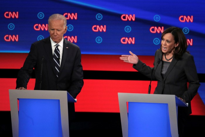 Joe Biden listens to Kamala Harris during a Democratic debate in July. Mr Biden was criticised by Ms Harris for working across the aisle with Republicans