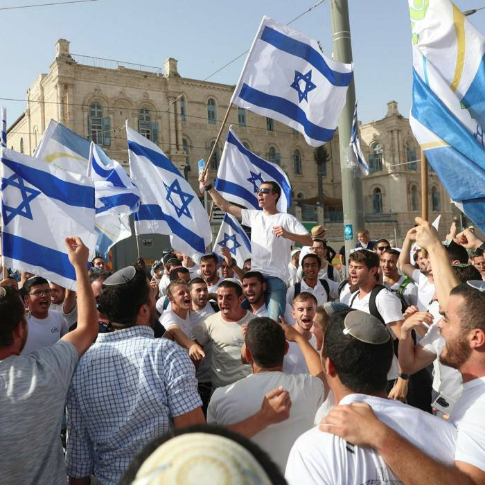 The Israelites are waving national flags during the annual Day of Jerusalem