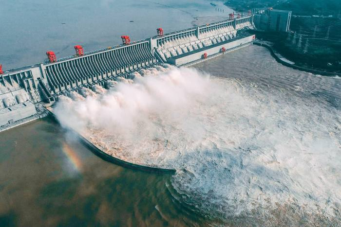 This aerial photo taken on August 23, 2020 shows water being released from the Three Gorges Dam, a gigantic hydropower project on the Yangtze river, in Yichang, central China's Hubei province. (Photo by STR / AFP) / China OUT (Photo by STR/AFP via Getty Images)