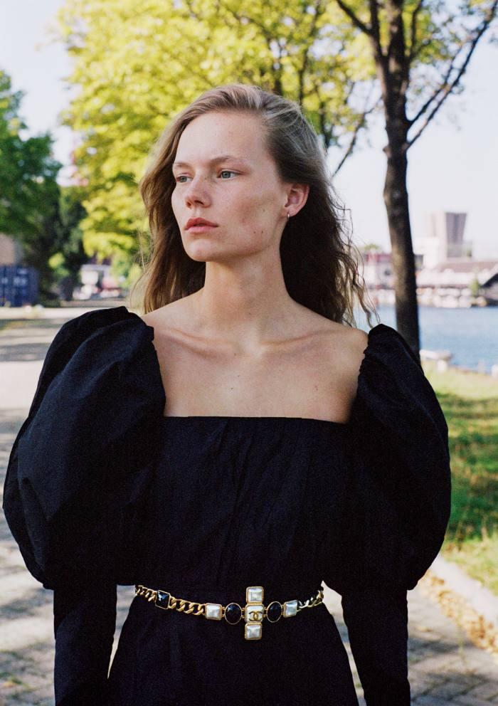 Nina de Bruijn wears Chanel taffeta dress, £7,285. Metal and resin belt, £1,730