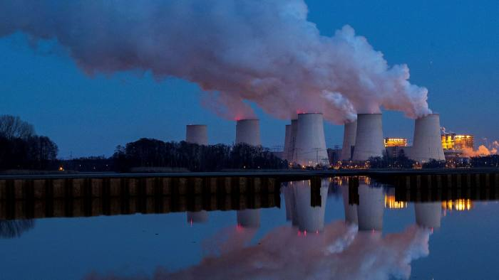 Air pollution rises from cooling towers at a lignite fired power plant in Germany. The EU is expected to increase its target for cutting its carbon emissions.