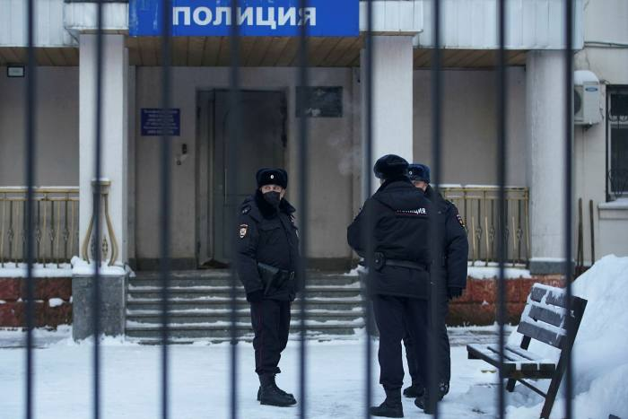 Officers outside the police station where Mr Navalny is being held, in Khimki, just outsidel Moscow