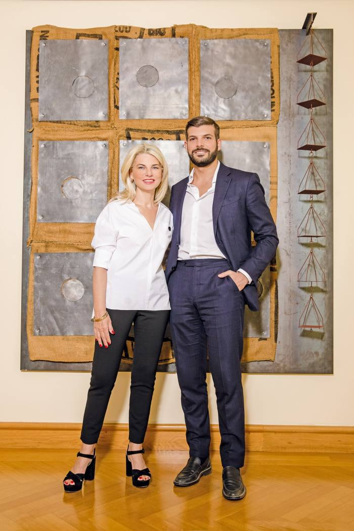 Irene Panagopoulos and Philippos ATsangrides Panagopoulos, in front of Untitled, 1986, by Jannis Kounellis
