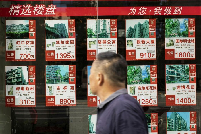 The list of apartments for sale is displayed at a real estate office in Shanghai