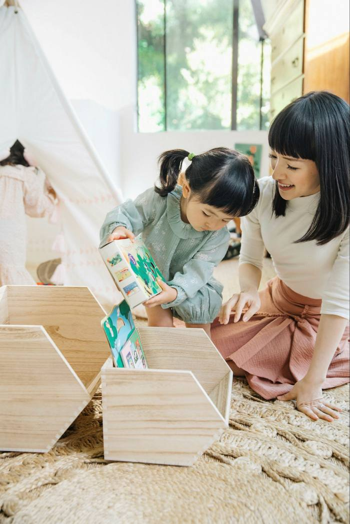 Kondo with her daughter in LA. She encourages her children to be tidy: 'A small trick is that I'm always going about my tidying with a smile on my face'