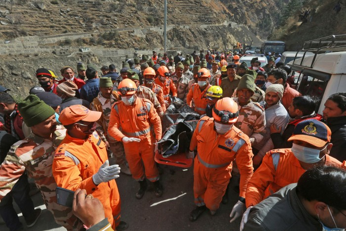 National Disaster Response Force personnel carry a body recovered from debris after a portion of the Nanda Devi glacier snapped off, releasing water trapped behind it, in Reni,  last month