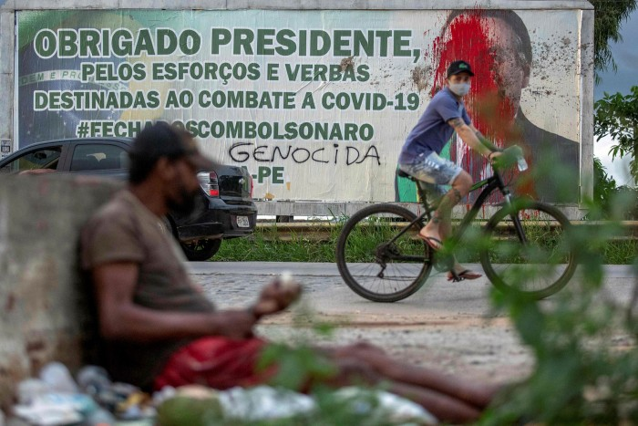 A billboard with the image of Bolsonaro is seen splattered with red paint last week in Carpina, Pernambuco