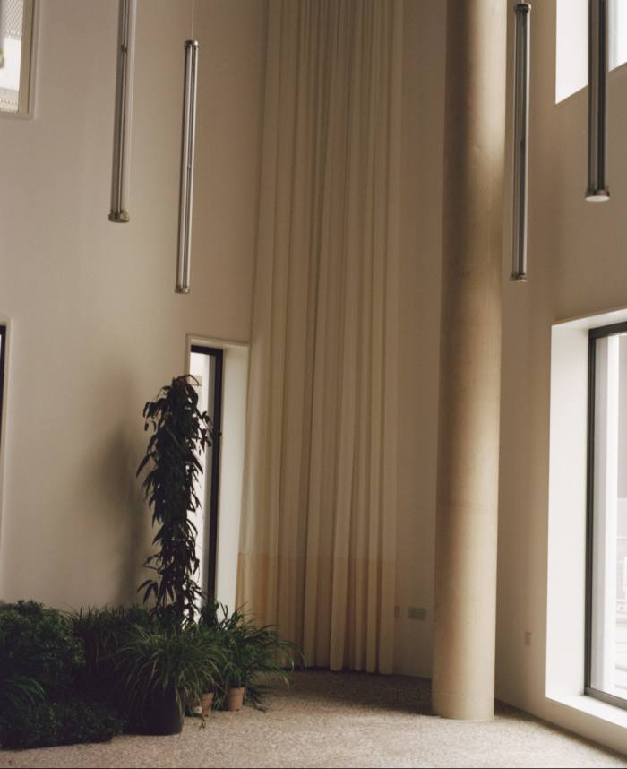 Interior of an empty room with high ceilings in the office