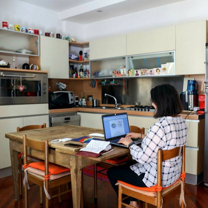 A woman works at home in Rome. Across Europe, nearly 40 per cent of employees worked remotely in the first half of the year, according to the European Commission
