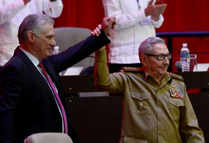 Miguel Díaz-Canel reacts as Raúl Castro raises his hand during the closing session of the 8th Congress of the Communist party in April