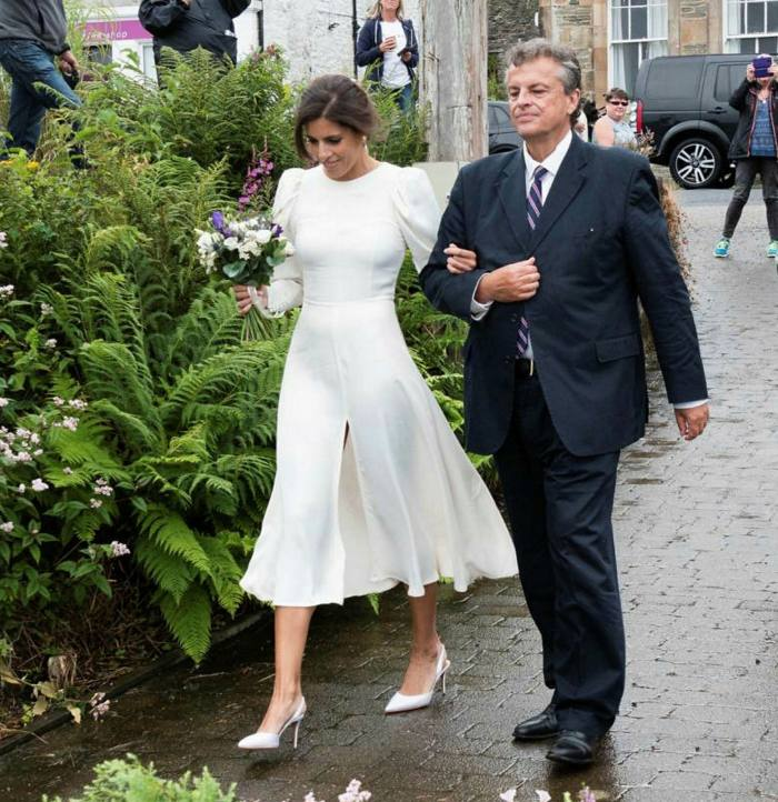 CNN anchor Christina Macfarlane with her father at her scaled-down wedding in Scotland earlier this year