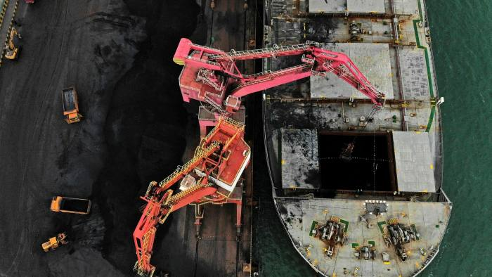Coal being unloaded from a ship at Rizhao port in east China. Chinese energy and industrial groups say problems with electricity supplies are partly due to an embargo on Australian coal imports