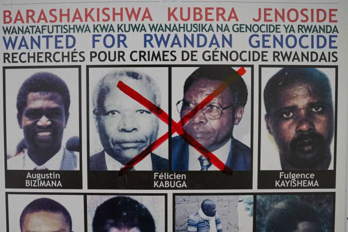 A red cross drawn over the face of Félicien Kabuga, one of the last key suspects in the 1994 Rwandan genocide, on a wanted poster after his capture. Kabuga, once one of Rwanda's richest men, had been on the run for 26 years