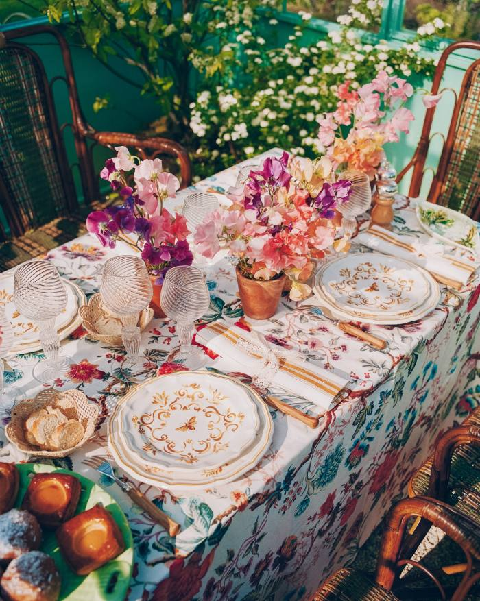 Dior Maison Bees – Earthenware and Honey dinner plates, £140 each, dessert plates, £110 each, Olive Tree knives and forks, £110 each, Baroque Murano water glass, £100, and wine glasses, £85 each
