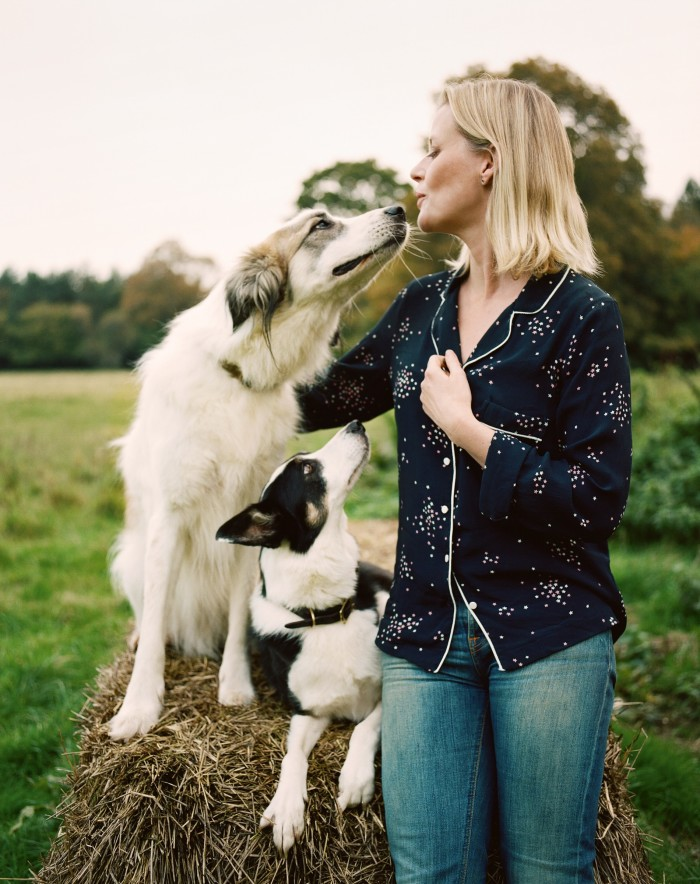 Perfumer Lucy Akhurst with her dogs Flossie (left) and Barney on the Highclere Estate